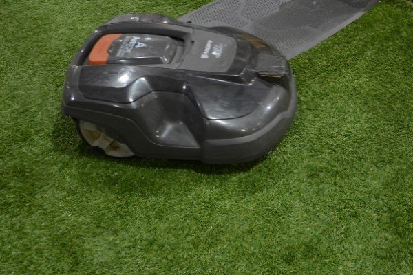 The Husqvarna Autmow Smartlawn Specialists drew a crowd of observers as it covered a swath of artificial turf.