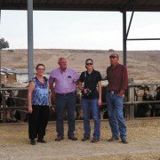 Sarah Horowitz (Negev Foundation), Larry Baker, Emily Mowrer, and Thierry Moens in front of Sharon Brothers' cattle feed lot.