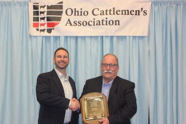 "Stan Smith with Fairfield County Extension received the Industry Service Award presented by Matt Reese of ""Ohio's Country Journal."""