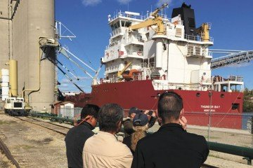 Members of Latin American Trade Team observe a vessel being loaded at The Andersons Edwin Drive terminal.