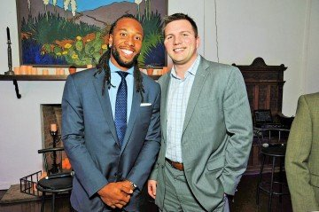 UpField Group founder Mark Inkrott and professional wide receiver Larry Fitzgerald
