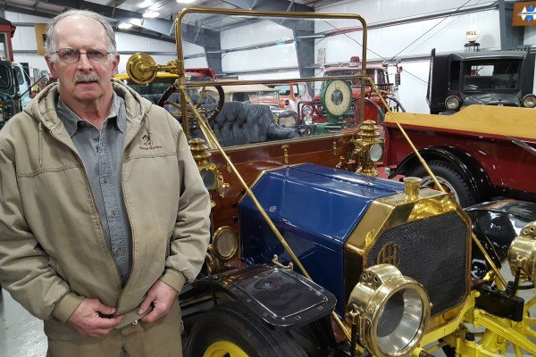 Rich Kleinoeder stands by his International Brass Car, a favorite at his museum.