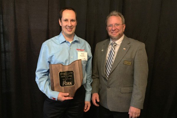 OPC President Rich Deaton presented Jamie Hundley with Birchwood Genetics, Inc. with the 2017 Swine Manager of the Year Award.