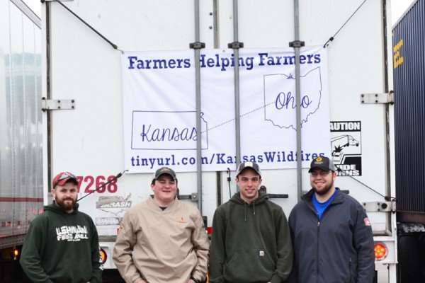 Four guys — Patrick Lehman, Jon Liechty, Brian Walker, Brayden Dues — a big truck and a trailer load of generosity including feed, fencing, cover top seed and other supplies.