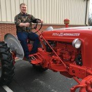 Senior FFA member Chris Link with his Best Restored Tractor