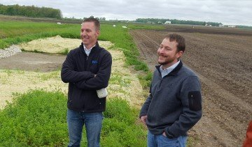 Chris Kurt (right) talks about the phosphorous removal beds in place at his farm