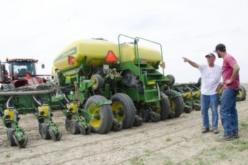 Tyler Drewes talks to his grandpa before getting back to planting this spring.
