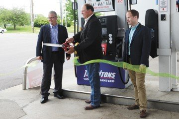 ODA director David Daniels cuts the ribbon for the new E85 pump with Tadd Nicholson (left) and Matt Nichols with Thorntons.