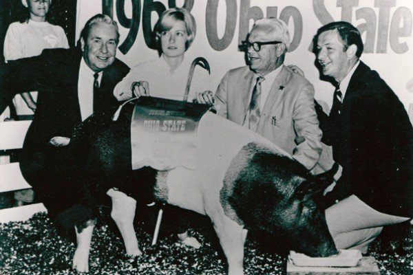 Nancy Campbell had the grand champion barrow in the first Sale of Champions in 1968. Gov. Jim Rhodes is on the left. The barrow sold for $4,400 to Pure Oil Plaza. Photo courtesy of the Ohio State Fair.