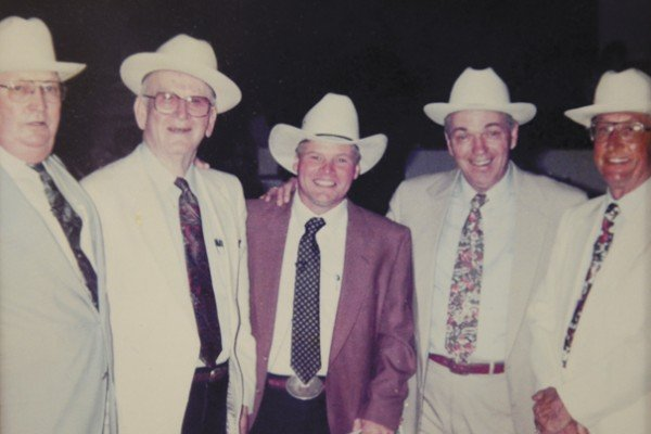 Photo of the 1991Sale of Champions auction team from the left are: Roger Wilson, Don Bradley, Johnny Regula, Merlin Woodruff, and Charlie Nash.