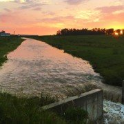 A beautiful sunset over a Darke County waterway, emphasis on the water. Photo by Greg McGlinch.