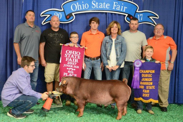 The Champion Duroc exhibited by Coby Hughes of Sabina sold to Buckeye Barrow Boosters, Fayette County Pork Producers, and Huffman's Market for $4,500.