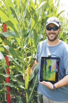 Graduate student Trey Colley stands with Terra Byte in the field at the Farm Science Review.