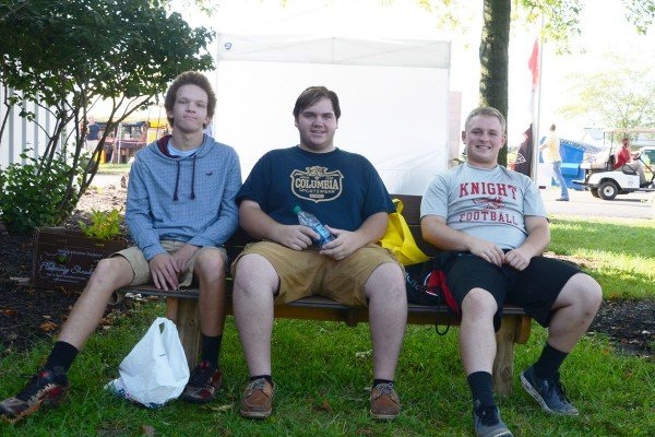 Jaylen Shatto, Lucas Current, and Josh Johnson from the Greenon FFA relax in the shade when the sun came out on Wednesday.