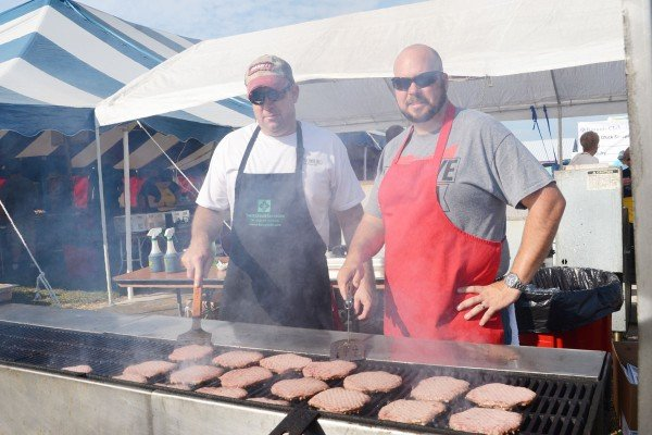 Kevin Summers and Travor Litchfield are getting ready for lunch at the Kiwanis tent.