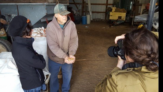 Tom Klein, an organic farmer in Carey, Ohio, shows off some of his specialty crop to Edible Columbus Editor Colleen Leonardi and her Photojournalist Rachel Joy Barehl