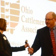 Joe Foster hands the gavel to Sasha Rittenhouse, the new Ohio Cattlemen's Association president.