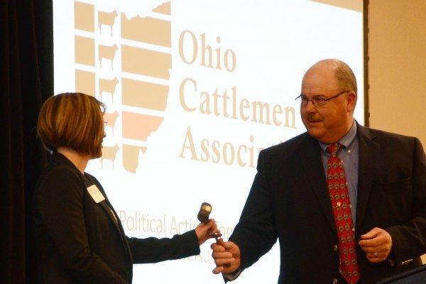 Joe Foster hands the gavel to Sasha Rittenhouse, the new Ohio Cattlemen's Association president.