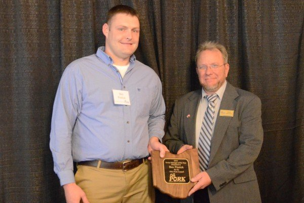 Ben Pitstick, left, was recognized as the Swine Manager of the Year presented by OPC president Rich Deaton.