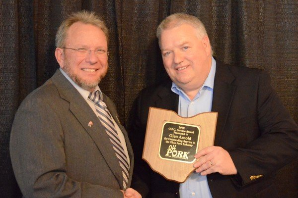 Glen Arnold (right) was recognized with the Pork Industry Service Award
