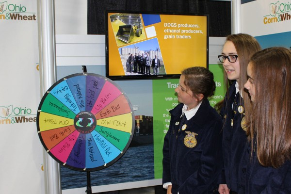 Global Impact FFA spinning to win at the Ohio Corn & Wheat booth